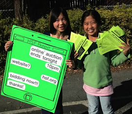 Students with online auction sign